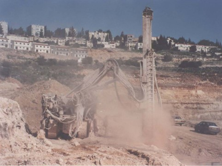 Fully computerized, remote controlled, rock pile drilling rig, 1990